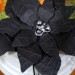 Photo shows the black flower that decorates the top of the Halloween Coffee Cup 3D project