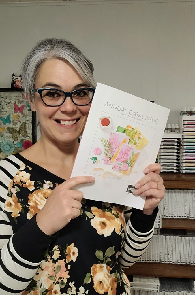 Photo of Denise Cox with catalogue